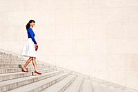 Woman moving down steps, Paris, Ile-de-France, France (thumbnail)