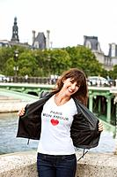 Woman enjoying at the riverside, Seine River, Paris, Ile-de-France, France (thumbnail)