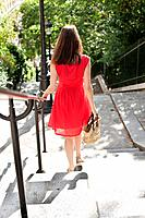Woman moving down staircases, Montmartre, Paris, Ile_de_France, France