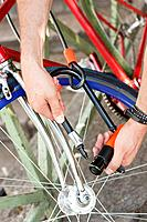 Close_up of a man´s hands locking his bicycle, Paris, Ile_de_France, France