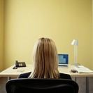 Caucasian businesswoman sitting at desk in office