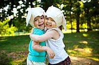 Smiling girls in mouse costume hugging