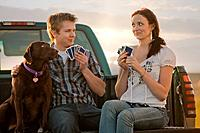 Caucasian couple playing cards in truck