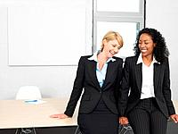 Businesswomen laughing