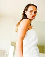 Young woman wearing a towel in bathroom