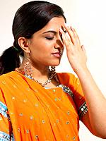 Woman putting bindi on forehead