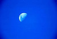 Half moon in blue sky, day shot