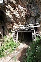 entrance to an old iron mine in the lakes of Covadonga, Asturias, Spain
