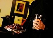 Arab lady holding dates and water
