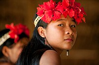 Portrait of young Embera woman with flower ornaments on head  Parara Puru village, Chagres, Panama, Central America