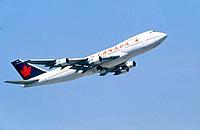 Boeing 747 flying in a blue sky
