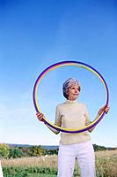 Senior Woman Holding Hula Hoops