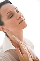 woman creaming neck