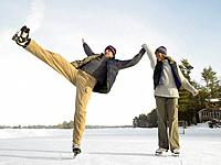 Couple Skating Outside, Man Falling