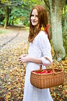 Ginger woman with basket of apples