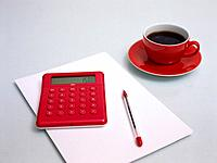 Pocket Calculator, Cup of Coffee, Biro and Sheet of Paper