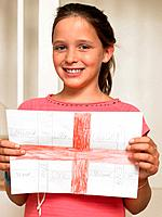 Girl holding a drawing of a george cross