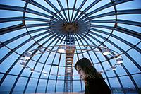 Woman Under Glass Dome at Night