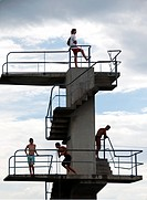 young men on the tower to the jumps in the water, beach on the Geneva Lake in Geneva called ´Paquis plage´, Geneva, Switzerland