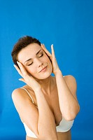 woman massaging head