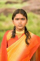 Girl in red yellow sari and gold necklace , village Vaitagvadi , Parbhani , Maharashtra , India MR688