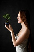 beauty woman with bonsai tree