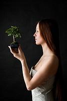 beauty woman with bonsai tree