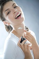 young woman creaming neck