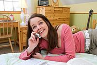 Female teenager phoning