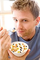 men eating breakfast cereals