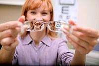 Red Haired Woman Offering Eyeglasses