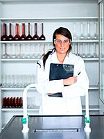 Portrait of a female scientist holding a clipboard in a laboratory
