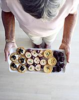 Woman Holding Tray of Canapes
