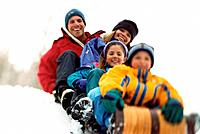 Family Riding a Toboggan