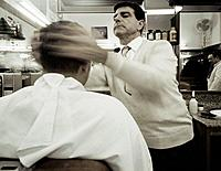 Barber Fixing Man´s Hair