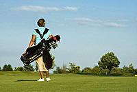 Woman Golfer Carrying Golf Bag