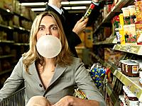 Woman in Shopping Cart Blowing Bubble