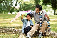 Father and Son Holding Kite