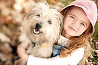 Little Girl with Pet Terrier