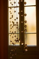 Crystal beaded curtain in front of a window.
