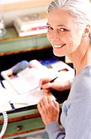 Middle_aged woman in her home office