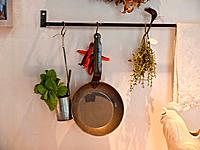 Kitchen decoration with hanging pots and pans