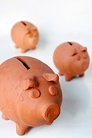 Close-up of three orange piggy bank