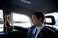 Portrait of a businessman in a taxi (thumbnail)