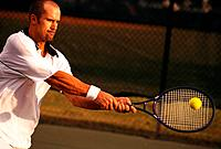Tennis Player Hitting Backhand Shot
