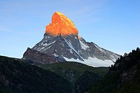 Matterhorn at sunrise with the top glowing in orange colour in the morning light, Switzerland, Valais