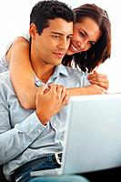 Portrait of romantic young couple using laptop on white background