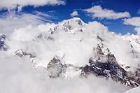 Snowcapped peaks behind clouds