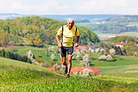 Elderly jogger training for his fitness jogging