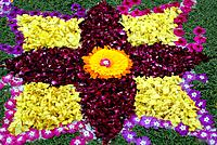 Rose petals swastika rangoli decoration